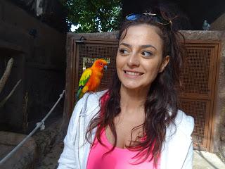 Yara with a small parrot in Marineland, Palma de Mallorca